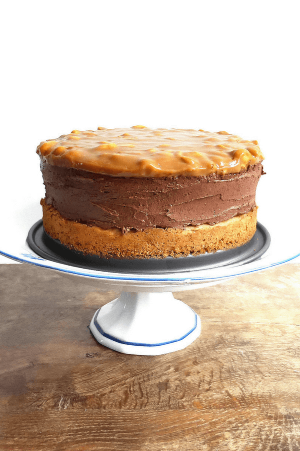 Chocolate Cheesecake with a Peanut Butter Cake Crust and Salted Peanut Dulce de Leche Topping